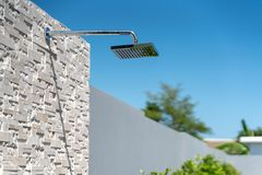 Exterior design out door shower head. Of pool villas stock photography