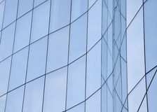 Exterior detail from the glass facade of an office building Stock Photo