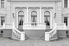 Exterior detail of neo renaissance building. Exterior detail of an old neo renaissance building with stairs and windows, black and white picture Royalty Free Stock Images