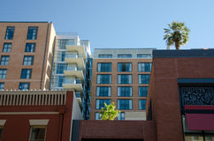 Exterior details of buildings in Gaslamp quarter, with palm trees Stock Photos