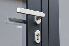 Exterior door handle and Security lock. On Metal frame Royalty Free Stock Images