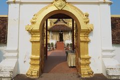 Exterior of the entrance to the Pha That Luang stupa in Vientiane, Laos. Stock Photo