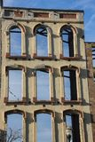 Facade of building on Main Street, Louisville, Kentucky, USA. Exterior facade of building that has been gutted out, blue sky can be seen through building windows royalty free stock photography