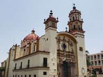 Exterior facade of a catholic church in the centre of Toluca city in State of Mexico. Exterior facade catholic church centre toluca city state mexico travel you royalty free stock photos