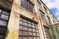 Exterior facade of a grungy commercial building Stock Photography