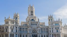 Exterior facade of the post office building in Plaza Cibeles in Madrid Spain. Beautiful sunny day with a blue sky stock images