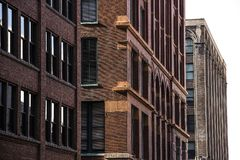 Exterior facade of pre-modern 1900`s architectural style commercial business office buildings downtown in city, brick, stone stock images