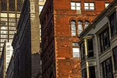 Exterior facade of pre-modern 1900`s architectural style commercial office business buildings in downtown city, brick, stone, bay stock images