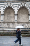 Santa Maria Novella Church; Florence; Italy with Couple Walking Stock Image