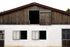 Horse stables. The exterior facade of the stables of a Horse Farm Stock Photos