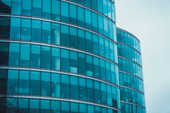 Exterior facade of two curved commercial buildings Stock Images