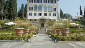 Exterior of fancy Italian hotel with garden