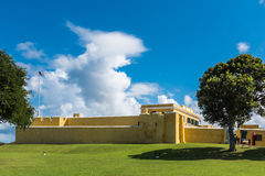 Exterior of Fort christiansted in St. Croix Virgin Islands. Wide angle view with tree and full side of the fort Royalty Free Stock Photography