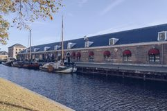 Exterior of `Funtastic Casino` in Den Helder. Den Helder, The Netherlands, October 13, 2018: exterior of Funtastic Casino with canal and boats in front of it royalty free stock photography