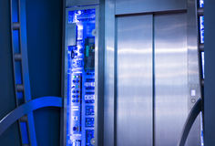 The exterior is a glass curtain wall elevator, blue tone chart. Royalty Free Stock Photo