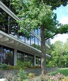 Office building, Riverdale, Maryland. Exterior of glass fronted office building with green landscaping in Riverdale, Maryland on sunny day royalty free stock photos