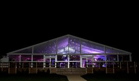 Party hall illuminated at night stock photography