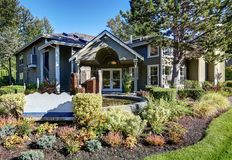 Exterior of gray house with beautiful landscape design. Royalty Free Stock Photography