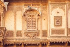 Exterior of great indian house with historical carved walls, balconies and stone design elements, Rajasthan of India. Royalty Free Stock Photography