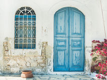 Exterior of Greek island traditional street with blue door, Kast. Typical exterior of Greek traditional town street with colorful buildings and marine blue door stock image