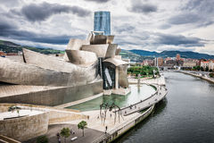 Exterior of The Guggenheim Museum and Iberdrola Tower. BILBAO, SPAIN - OCTOBER 1: Exterior of The Guggenheim Museum and Iberdrola Tower on October 1, 2013 in Stock Photos