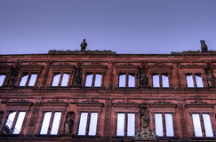 Exterior of Hidelberg Castle. A picture of the facade of the Heidelberg Castle in Germany. This view shows the rows of windows in the building reflecting the Royalty Free Stock Images
