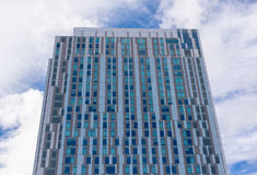 Exterior of high-rise apartment building. Exterior of a modern high-rise apartment building royalty free stock image