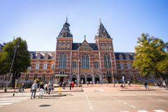 Exterior for of the historic Rijksmuseum with people in view. royalty free stock photography