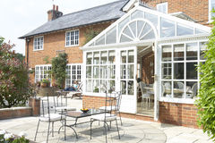Exterior Of House With Conservatory And Patio Stock Photo