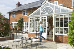 Exterior Of House With Conservatory And Patio Royalty Free Stock Photos