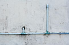 Exterior of a house with guttering , Pipe outside the house Royalty Free Stock Photos