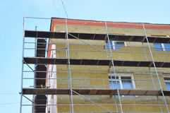Exterior house wall heat insulation with mineral wool, building under construction. Insulation is defined as a material or combination of materials which Royalty Free Stock Photos