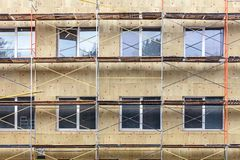 Exterior house wall heat insulation with mineral wool. thermal protection of building. Facade stock images