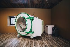 Exterior of individual hyperbaric recompression chamber. royalty free stock photo