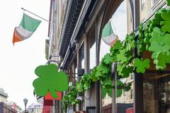 Exterior of irish pub decorated with shamrocks for St Patricks D. Oute street view of irish pub decorated with shamrocks for St Patricks Day Royalty Free Stock Photos