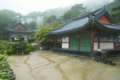 Exterior of the Jeondeungsa temple buildings on a rainy day in Incheon, Korea. Royalty Free Stock Images