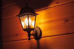 Exterior lantern on wooden house Stock Photography