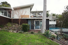 Exterior of a large mid century modern Australian home with pool Stock Photography