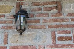 Exterior light fixture mounted on brick wall with copy space. Energy saving light bulb installed. stock images