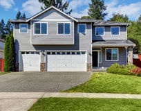 Exterior of luxurious grey house with double doors garage. Stock Image