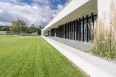 Exterior of a luxury house. With a lawn, and a terrace stock photos