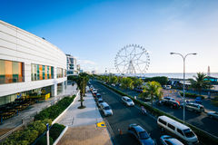 The exterior of the Mall of Asia and ferris wheel, in Pasay, Met Royalty Free Stock Photography