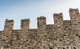 Exterior of medieval castle showing battlements. isolated on white background Stock Images