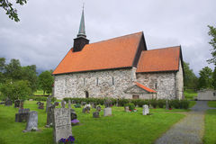 Exterior of the medieval Stiklestadt church and cemetery in Stiklestadt, Norway. Royalty Free Stock Photos