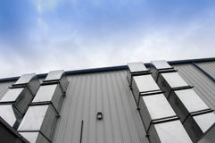 Exterior metal duct work. On a new commercial building stock photography