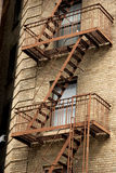 Exterior metal fire escapes on apartment building, Greenwich Village Stock Photos