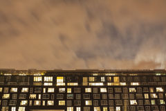 The exterior of a modern apartment block at night Stock Photography