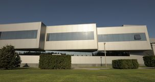 Exterior of modern factory, exterior of the modern plant, Modern plant panorama, building with large glass panes, modern. Exterior of modern storehouse or stock video footage