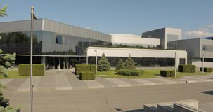 Exterior of modern factory, exterior of the modern plant, Modern plant panorama, building with large glass panes, modern. Exterior of modern storehouse or stock video