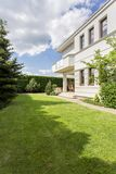 Exterior of modern house. With beauty garden Royalty Free Stock Photo